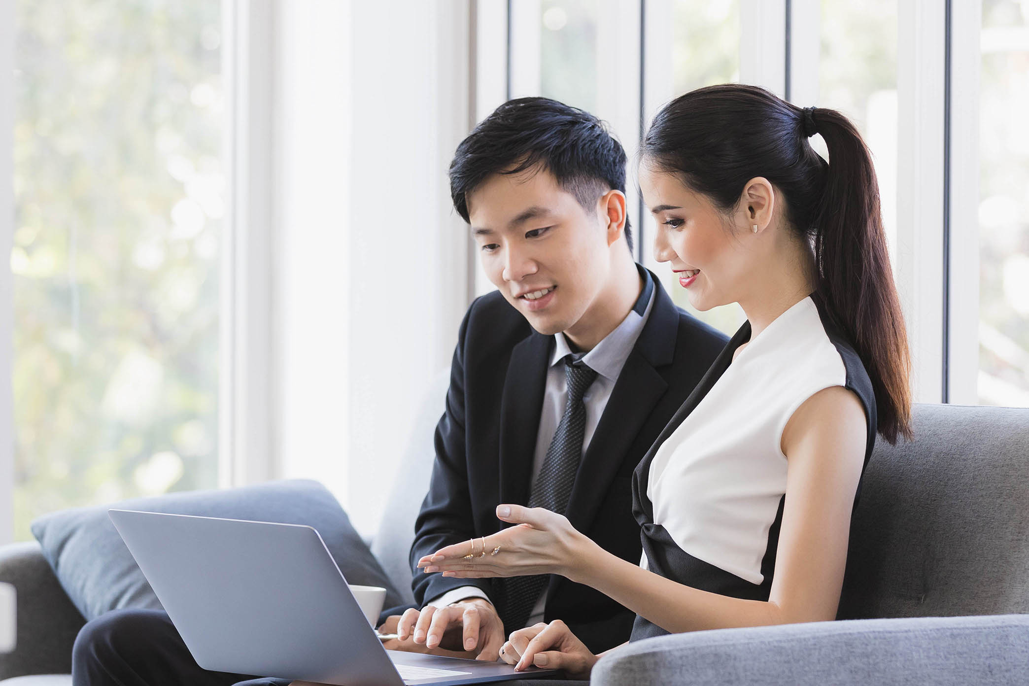 Two People Collaborating on Sales Enablement Platform